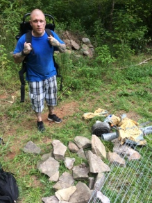 filling backpacks with stone to haul up the mtn.